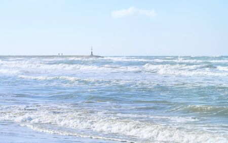 Beach and sea in south italy on a windy day with waves and sun, travel, holiday concept. Good background with free copy space