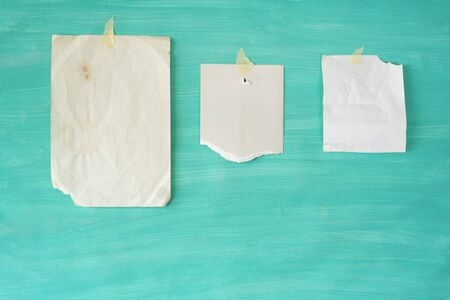 Blank leaflets, torn paper notes on message board, free copy space