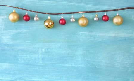Christmas decoration with christmas balls and green painted background, mock up free copy space