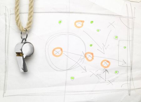 whistle of a soccer  football referee or trainer, with match tactics scribble