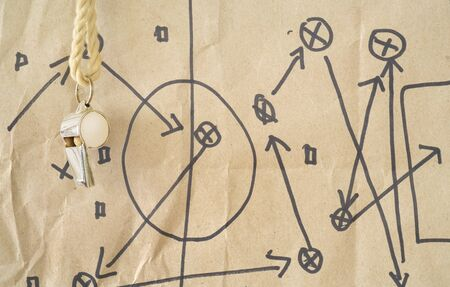 whistle of a soccer  football referee or trainer, with match tactics scribble on cardboard