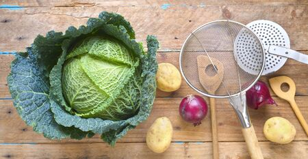 Cabbage head, vegetables and kitchen utensils, ingredients for a hot pot in the winter, flat lay Zdjęcie Seryjne