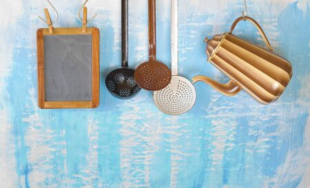 vintage kitchen utensils for commercial kitchen and menu blackboard, restaurant,cooking, culinary concept. Free copy space.