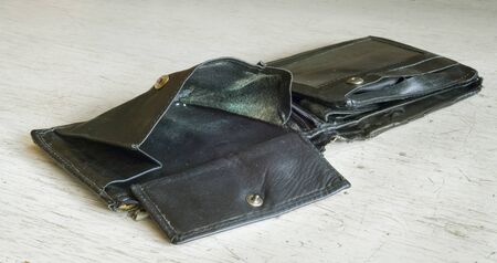 empty wallet or purse, symobol for poverty, destitution, smashup or  tax burden