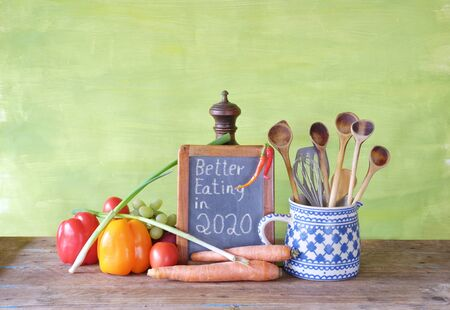 Healthy food,vegatables and kitchen utensils. Concept, better eating in the new year 2020 Zdjęcie Seryjne