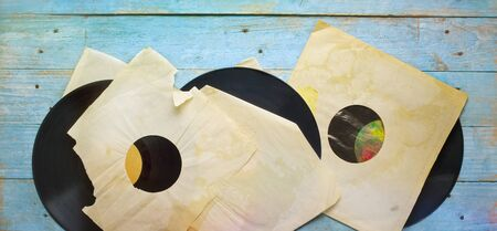 Old grungy vinyl records with yellowed torn inner sleeves, flat lay, free copy space Zdjęcie Seryjne