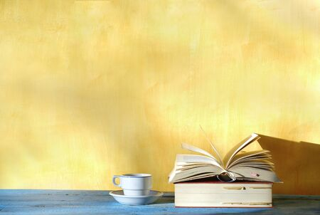 Open book, cup of coffee, free copy space. Reading, education, literature, learning, book fair concept  Stock Photo