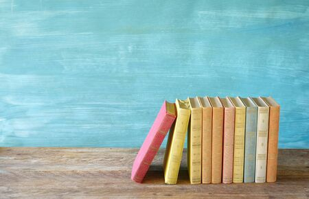 Row of multicolored books, free copy space. Reading, education, literature, learning, book fair concept  Stock Photo