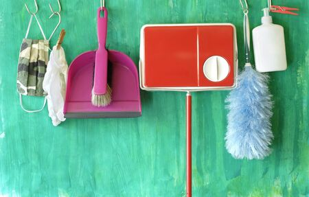 House cleaning in times of coronavirus, face mask,gloves,germicide, cleaning utensils,concept,good copy space