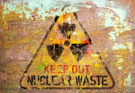 grungy nuclear atom waste warning sign, rotten and rusty, symbol for dangers of atomic energy