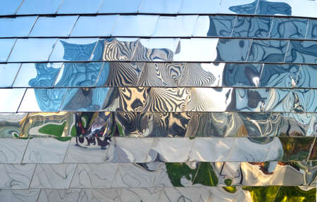 optical reflection on the metal facade of a modern building forming abstract patterns, free copy space