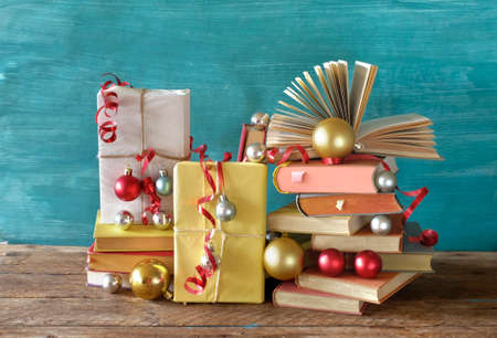 books as christmas gift, christmas present, reading, literature, education, making a gift concept