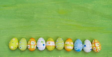 multicolored easter eggs in  a row, design mock up template or background, large free copy space