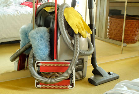 Spring-cleaning concept with vaccuum cleaner,carpet sweeper,feather duster and rubber glioves