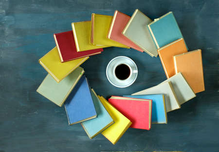 Books and cup of coffee,eye shape.Home office,reading,literature,education,library,back to school concept, flat lay, copy space