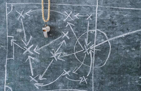 whistle of a soccer coach or referee and soccer tactics diagram on blackboard, great soccer event this year Standard-Bild