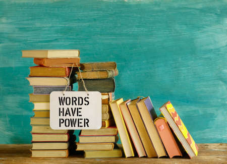 Stack of books and saying Words have power, education reading,learning concept