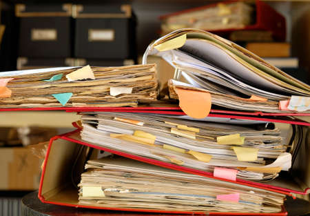 messy old file folders and documents, government, business and administration shut down in times of conceptual picture, narrow focus,close-up Standard-Bild