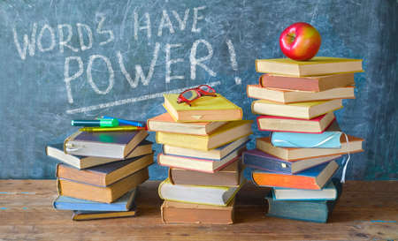Stack of books and caption on black board Words have power, back to school,education reading,learning concept