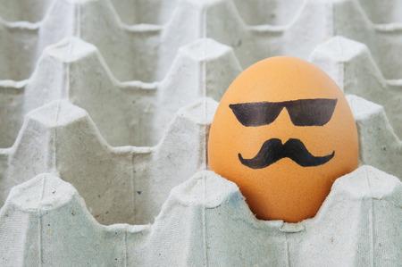 easteregg: mustache face Eggs  arranged in carton Stock Photo