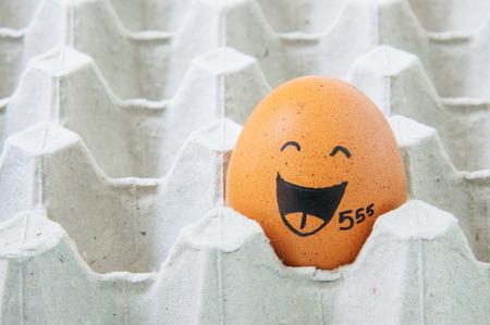 eastertime: augh face Eggs  in empty carton Stock Photo