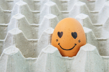 breakfast smiley face: love face Eggs in brown paper box Stock Photo