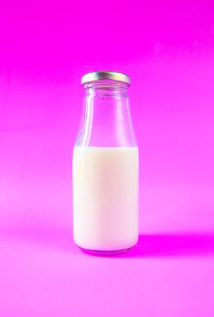 dairying: milk bottle on purple background