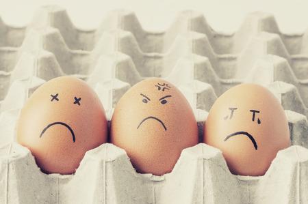 easteregg: three brown Eggs arranged in carton