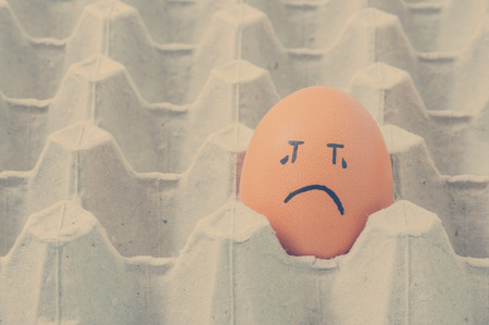 teary: brown eggs face crying arranged in carton Stock Photo