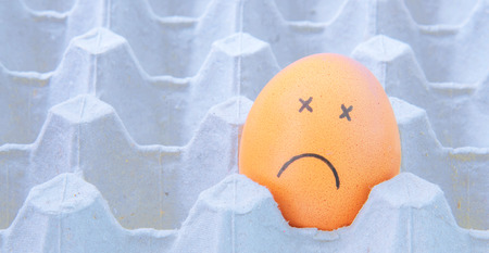 eastertime: sick face Eggs in brown paper box Stock Photo
