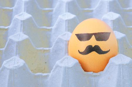 eastertime: mustache face Eggs  arranged in carton Stock Photo