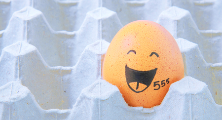 easteregg: augh face Eggs  in empty carton Stock Photo