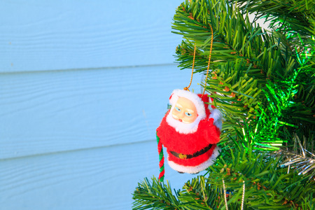 silhouettable: Santa Claus on chrismas tree,in garden background