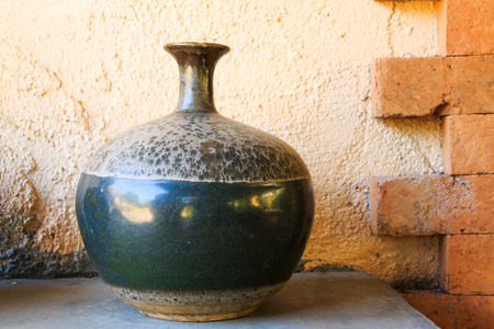 A Rustic Vase On Cement Wall Stock Photo Picture And Royalty Free