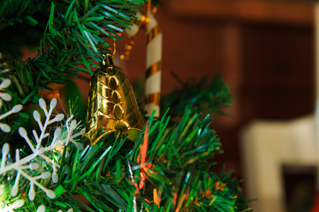 silhouettable: Christmas decoration, pine cones,gift,baubles,on christmas tree Stock Photo