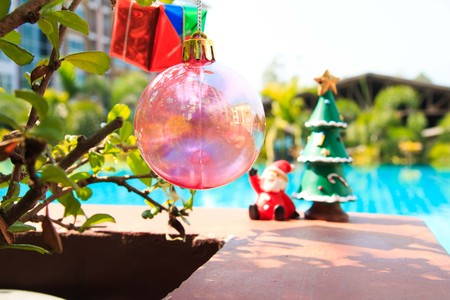 silhouettable: santa doll with christmas tree ,pool background