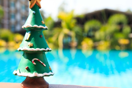 silhouettable: christmas tree ,pool background Stock Photo
