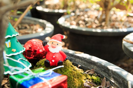 silhouettable: santa doll in forest ,gift box,Christmas baubles Stock Photo