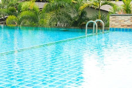 refreshing: a refreshing blue swimming pool  in condominium Stock Photo