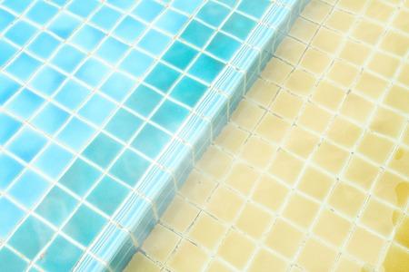 refreshing: a refreshing yellow swimming pool  in condominium
