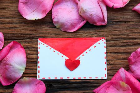 pink rose petals: Love letter in heart of pink rose petals