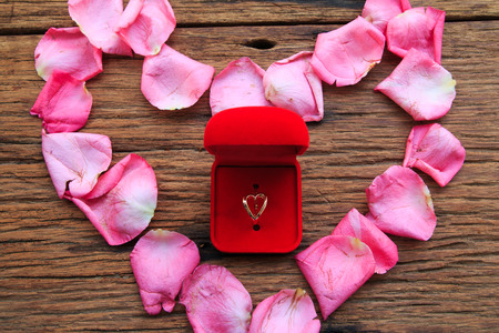 rose petals: Ring in Red Velvet Box  in heart of pink rose petals