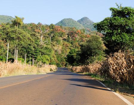 r image: asphalt road  in mountains