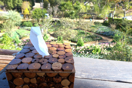 sniffles: Wooden tissue boxes in cafe
