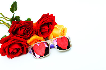 orange roses: Red and orange roses flowers with Heart shape sun glasses  on white background