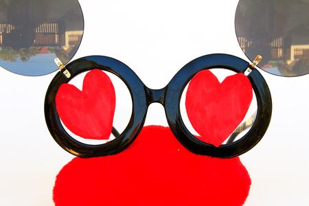 sun glasses: Heart shape sun glasses on white background