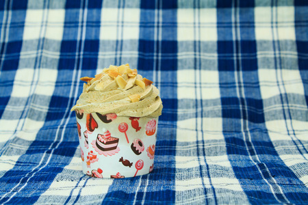 picnic tablecloth: Coffee Cupcake with creamy with Almonds on blue picnic tablecloth