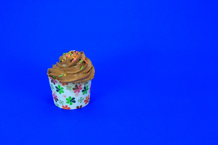 frosting': Chocolate Cupcake with creamy chocolate frosting on blue background