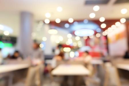 Onduidelijk beeldrestaurant met bokehachtergrond Stockfoto