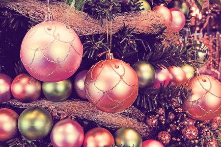 Colorful balls hanging from a decorated Christmas tree. 스톡 콘텐츠